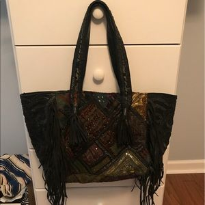 Clever carriage fringe tote